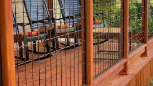 exterior mesh panel porch rail at mccoy millwork